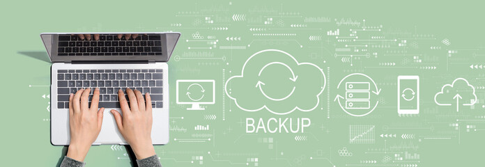 Backup concept with person using a laptop computer