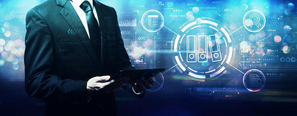 Compliance theme with businessman holding a tablet computer