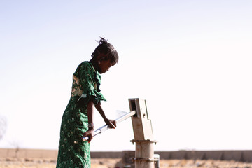 Little Black Women Carrying Pure Water with major difficulties