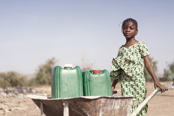 Little Indigenous Girl getting Tap Water with major difficulties