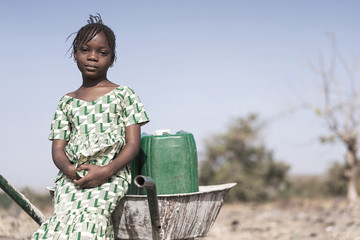 Working African ethnicity Infant getting pure Water in a natural environment