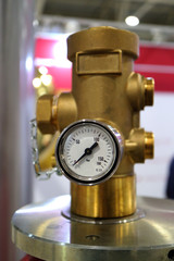 An image of a working pressure gauge with an emergency pressure relief valve of a gas cylinder.