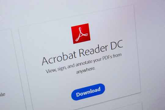Ryazan, Russia - July 11, 2018: Adobe Acrobat Reader, software logo on the official website of Adobe.