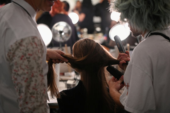 A model gets hair and makeup done backstage before Brandon Maxwell's Fall/Winter 2020 collection show during fashion week in New York
