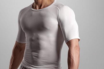 Closeup photo of fit athletic man with sportive muscular body