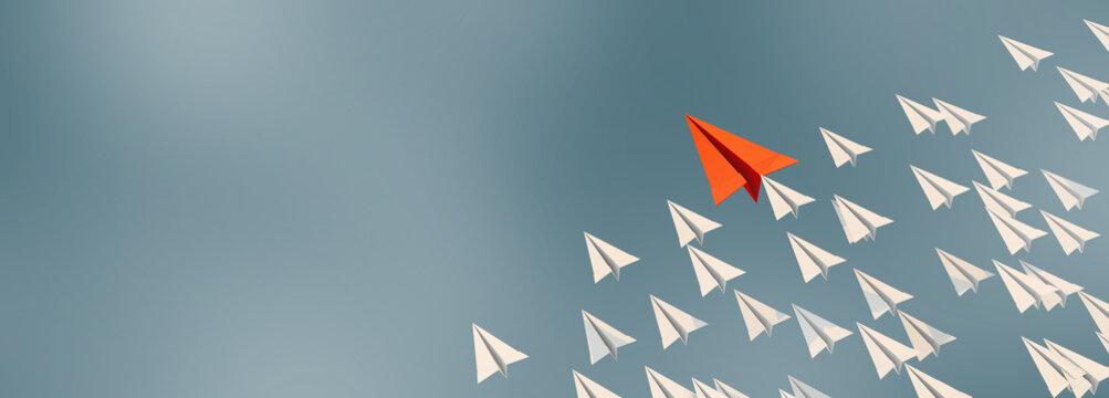 3D illustration of leadership success business concept rocket paper fly over color background lead rocket stand out of other paper rocket follower