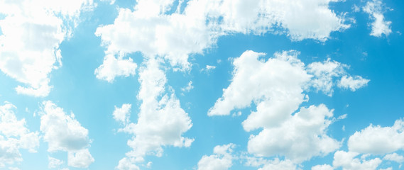 Blue sky background. Heaven peace tranquility. White clouds sunlight. Summer day.