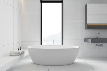 White tile bathroom interior, tub and sink