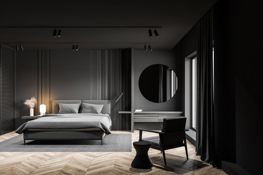 Gray master bedroom interior with makeup table