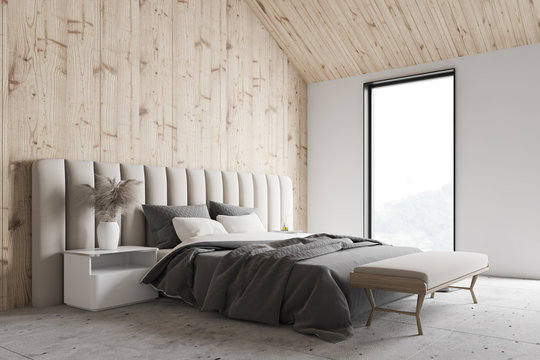 Wooden and white attic bedroom interior