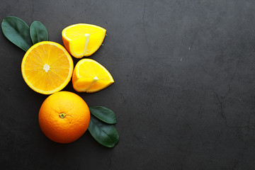 Orange citrus fruit on a stone table. Orange background.