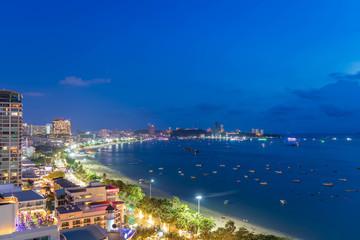 Pattaya bay beach harbor, famous seaside resort city, during twilight, Chonburi, Thailand Wall mural