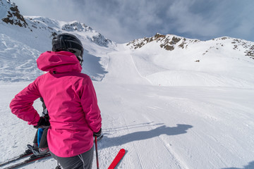 Girl skier watching empty slope in Solden ski resort, Solden, Austria, Europe