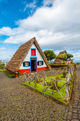 Traditional historic thatched houses with strawy roofs on Madeira island, Santana, Portugal