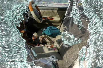 Bullet holes and blood are seen in a victim's car following a gun battle involving a Thai soldier on a shooting rampage are seen, in Nakhon Ratchasima