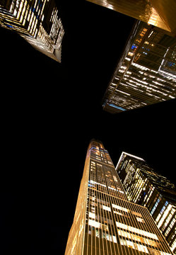 New York City skyscrapers at night from below