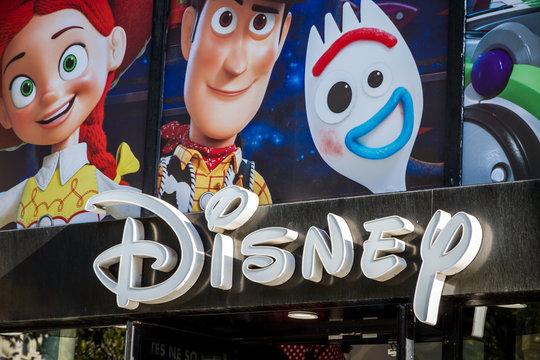 Paris - September 10, 2019 : The Disney store entrance sign on Champs-Elysees avenue