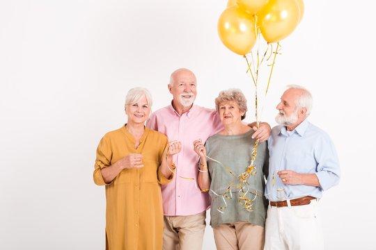 Seniors celebrating birthday in room