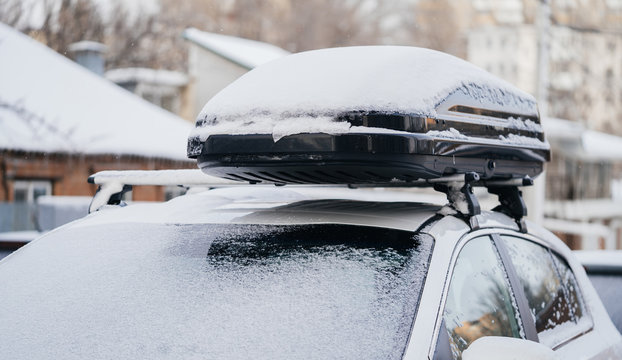 Roof rack for travel on a car roof in winter in the snow. Family Transportation and travel in winter.
