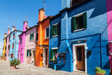 Bright colorful houses on Burano island on the edge of the Venetian lagoon. Venice, Italy