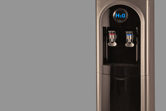 Clear drinking water concept poster with copy space. Consumption of pure water while dieting process. Healthy life style. Closeup of water cooler machine