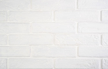White natural brick background with texture.