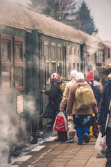 VELINGRAD, BULGARIA - FEBRUARY 8, 2020: BDZ narrow gauge train and people at the railway station in Velingrad, Bulgaria