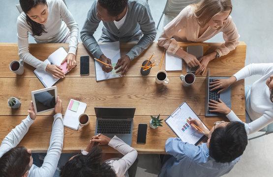 Multiracial business team having meeting, top view