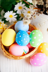 Happy Easter. Congratulatory easter background. Easter eggs and flowers. Background with copy space. Selective focus.