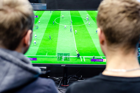 Kyiv, Ukraine - April 12, 2019: The guys are playing a football video game.