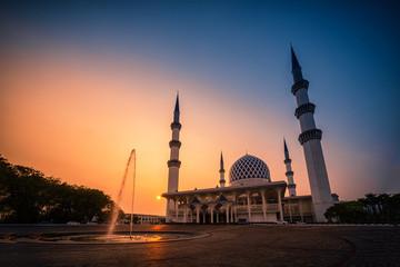 Sultan Salahudin Abdul Aziz Shah Mosque at sunset in Shah Alam, Malaysia.