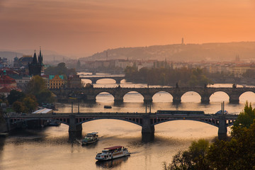 Bridges Crossing Vltava River in Prague by Sunset