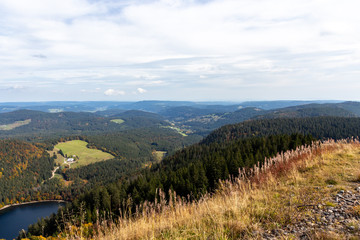 Scenic view at landscape and lake Feldsee from Feldberg, Black Forest in autumn with multi colored vegetation