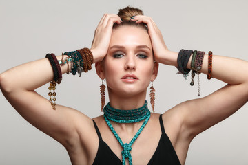 Beautiful woman in collar necklace and multiple bracelets.