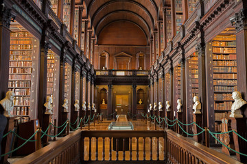 DUBLIN, IRELAND - FEB 15, 2014: Old books on shelves in the Long Room library in the Trinity College.