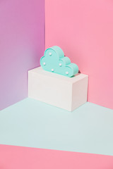 Summer party composition on a pink geometric background with plastic blue cloud. Good night dreaming concept
