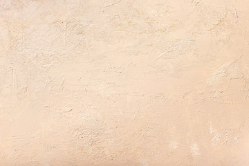 decorative plaster of neutral beige color. textured background. monochrome. selective focus.
