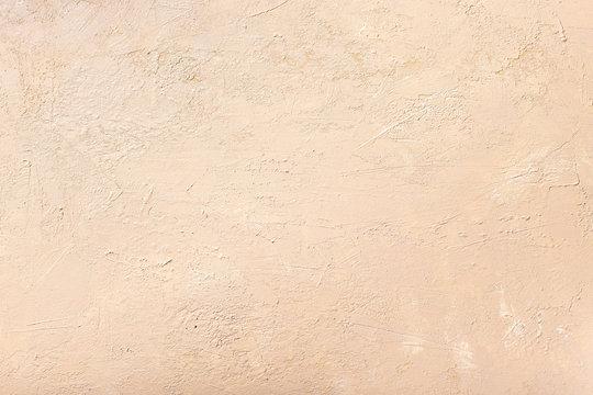 decorative plaster of neutral beige color. textured background. monochrome. selective focus.