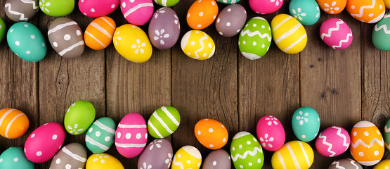 Wall Mural - Colorful Easter Egg banner with double border against a rustic old wood background. Above view with copy space.