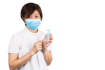 Asian woman recommends facemask and hand sanitizer for protection against virus germs