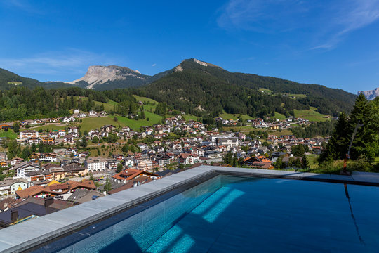Swimming pool in the Dolomites with a view of Ortisei, Italy