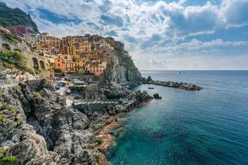 Italian coastline and colorful Manarola village in Cinque terre, Italy.