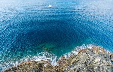 mediterranean  sea and Italian coastline at Manarola fishing village in Cinque Terre, Italy.