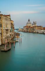 Famous view of Basilica di Santa Maria della Salute and grand canal from Accademia Bridge, Venice, Italy.