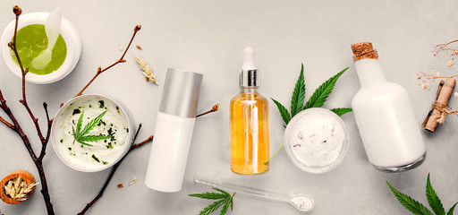Cosmetics with cannabis CBD oil on light background. Concept natural skin care. Banner