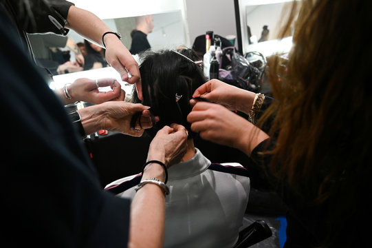 A model gets hair and makeup done backstage before Tory Burch Fall/Winter 2020 collection show during fashion week in New York