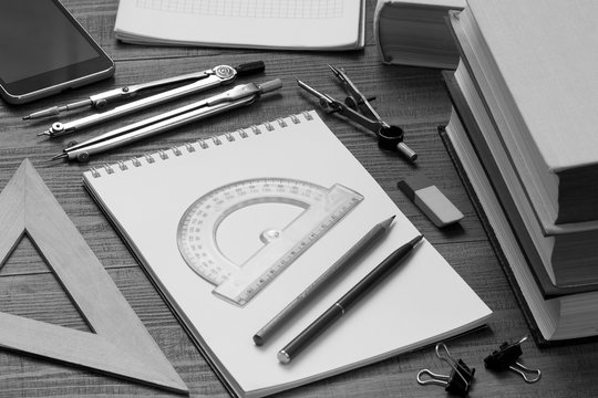 drawing instruments, notebooks and books for preparing for math and drawing