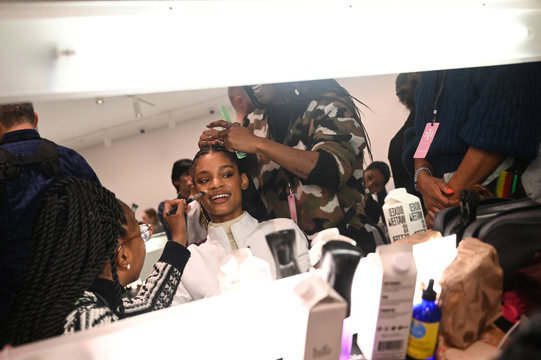 Model Theresa Hayes gets hair and makeup done backstage before Tory Burch Fall/Winter 2020 collection show during fashion week in New York