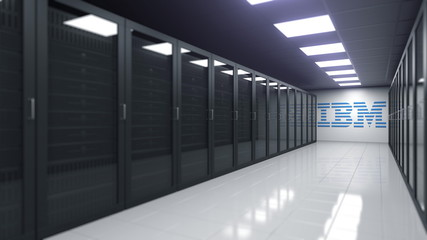 Logo of IBM on the wall of a server room, editorial 3D rendering