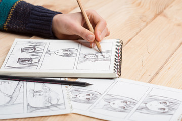Artist drawing an anime comic book in a studio. Fotobehang